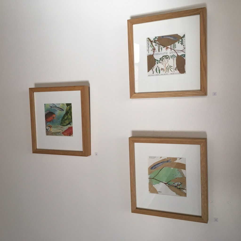 "Installation View - Fish out of Water – A Visitor, gouache, and pages from ""The Reader's Digest Complete Atlas of Australia"" 1968 edition, 12 x 12 cm, 2014. Fish out of Water – Eucalypt, gouache, gum leaves, and pages from ""The Reader's Digest Complete Atlas of Australia"" 1968 edition, 12 x 12 cm, 2014. Fish out of Water – Fishing, gouache, gum leaves, and pages from ""The Reader's Digest Complete Atlas of Australia"" 1968 edition, 12 x 12 cm, 2014."