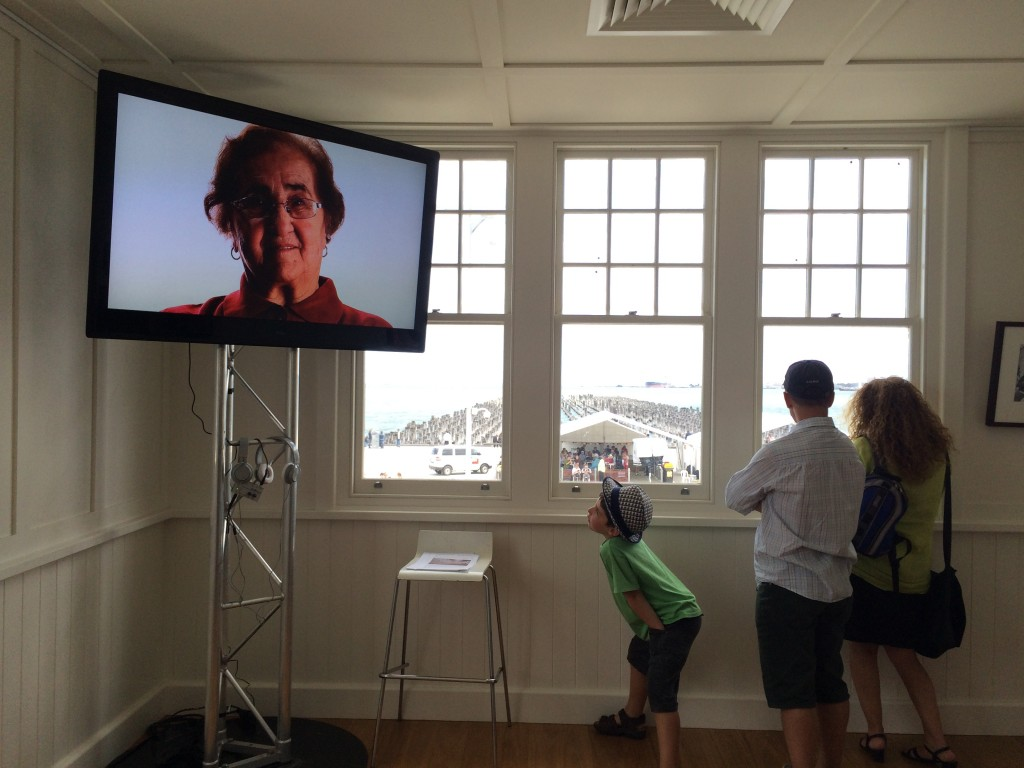 The Mother Tongue video showing in the Gate House. First generation immigrants from Regional Victoria sharing their stories of leaving Italy, the journey and their arrival. The view out the window is of the Princes Pier pylons.